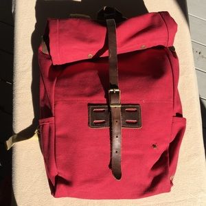 Archival Clothing rolltop rucksack, red canvas